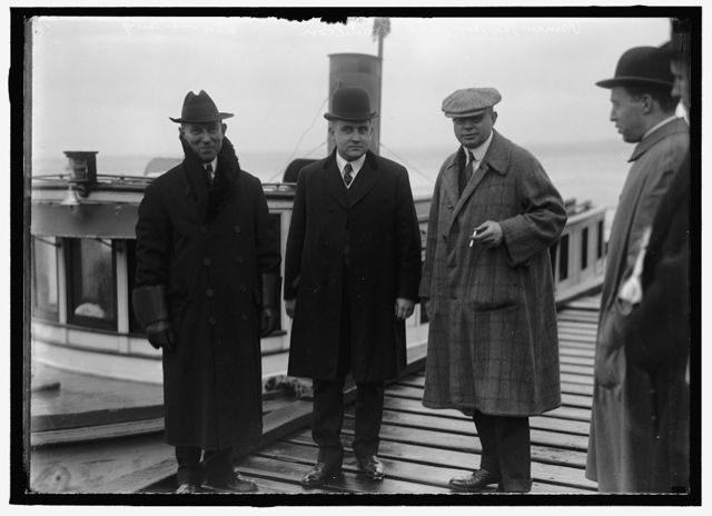 APPAM, H.M.S. BRITISH SHIP CAPTURED BY GERMANS, INTERNED IN U.S. SCENE AT NEWPORT NEWS, VA. WHEN APPAM WAS RUN INTO PORT BY GERMANS: VON SCHILLING VICE COUNSUL OF NEWPORT NEWS; COLLECTOR OF PORT OF NEWPORT NEWS; PRINCE VON HARTZFELD