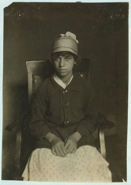 [Applying for work paper first time Gertrude Pereira, 99 Stowe St., 14 years old - to be a ring spinner in Borden City Mill. 6th Grade, Wiley School. Learned to spin in school vacations. Rather go to work.]  Location: Fall River, Massachusetts. / Lewis W. Hine.