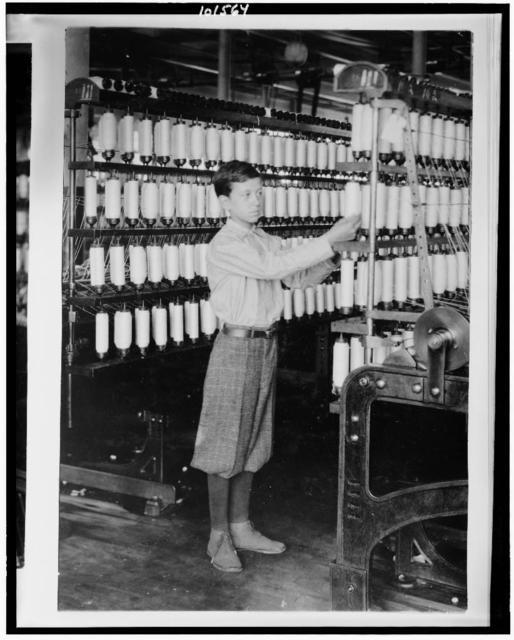 [Back boy - 14 years old - Mule room. Berkshire Cotton Mills.]  Location: Adams, Massachusetts. / Lewis W. Hine.