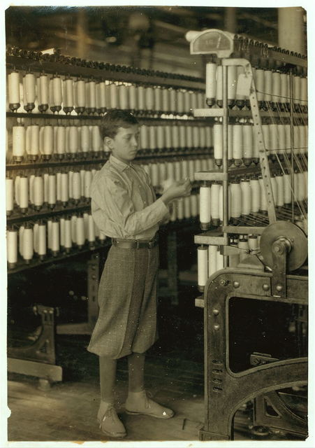 Back boy - 14 years old - Mule room. Berkshire Cotton Mills.  Location: Adams, Massachusetts / Lewis W. Hine.