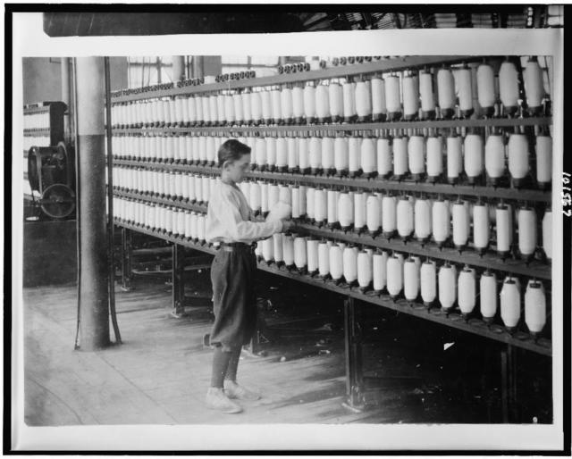Back boy - Mule room - 14 years. Berkshire Cotton Mills.  Location: Adams, Massachusetts / Lewis W. Hine.