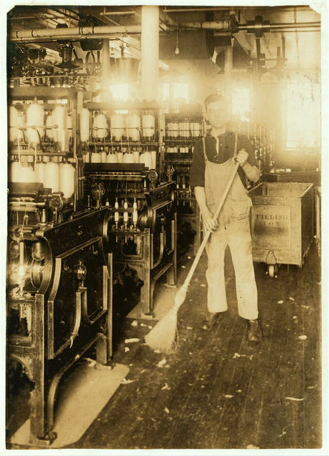 [Boy holding broom near textile machinery] Location: Fall River, Massachusetts. / Lewis W. Hine.