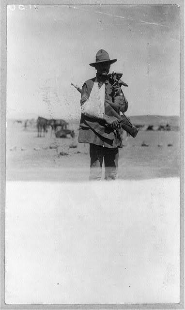 Corporal Richard Tannous of the 13th Cavalry who was shot through the arm at Parral, Mexico, Mexican-U.S. campaign after Villa, 1916 / photo by Underwood & Underwood.