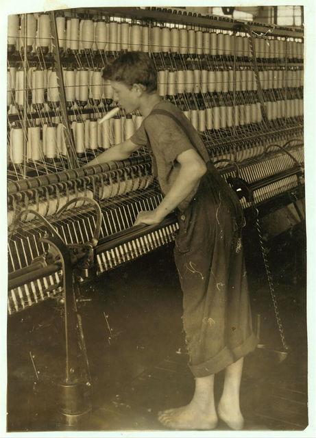 Doffer - Mule room - 16 years. Berkshire Cotton Mills.  Location: Adams, Massachusetts / Lewis W. Hine.