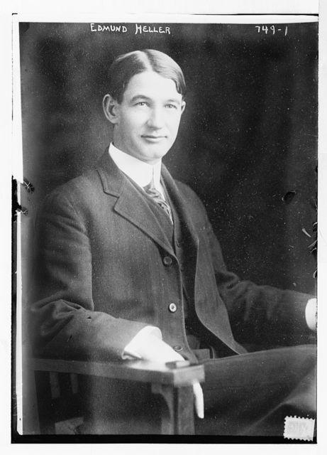 Edmund Heller, seated