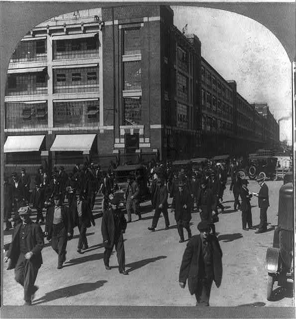 Employees leaving the Ford Motor Company factory at Detroit, Mich.