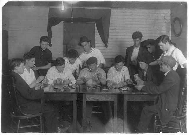 "Evening recreation of the ""Young Holy Ghosters"" - Ages 15 - 25, average is 18 - all mill workers - all Portuguese. Whole House on George Street. Great need of leadership.  Location: Fall River, Massachusetts / Lewis W. Hine."
