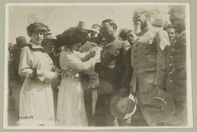 General Obregon receiving medal from admirers in Celaya, Mexico Mexican-U.S. campaign after Villa, 1916.
