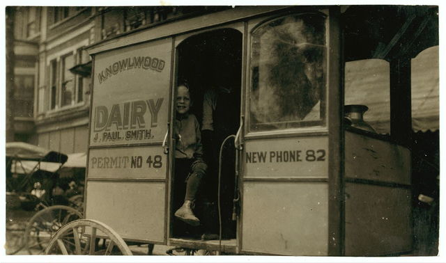 Helper on a dairy wagon. See report.  Location: Bowling Green, Kentucky / L.W. Hine.