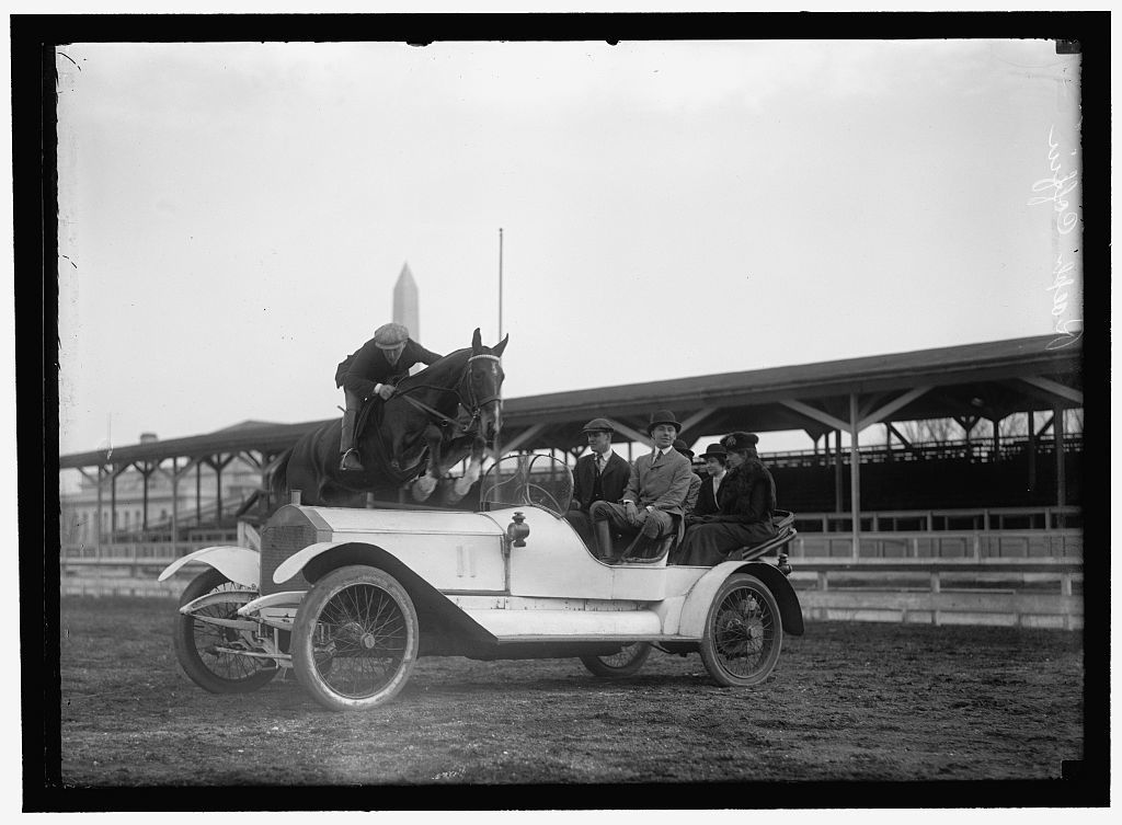 HORSE SHOWS. RALPH COFFIN JUMPING HIS HORSE OVER SYLVANUS STOKE'S ROLLS ROYCE