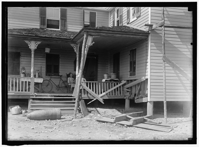 INDIAN HEAD, MD. NAVY PROVING GROUND. RESIDENCE OF GEORGE SWANN, DAMAGED BY 16' SHELL THAT HIT ANOTHER IN SANDBANK, AND WAS DEFLECTED OVER COUNTRY AT 3/4 ANGLE. THE SHELL, WHERE IT STOPPED IN DOORYARD
