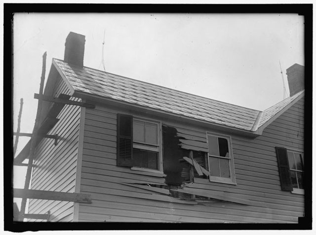 [INDIAN HEAD, MD. NAVY PROVING GROUND. RESIDENCE OF GEORGE SWANN, DAMAGED BY 16' SHELL THAT HIT ANOTHER IN SANDBANK, AND WAS DEFLECTED OVER COUNTRYAT 3/4 ANGLE]