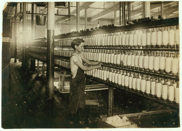 King Philip - Mule Spinning Room. Back boy - Roving. Charles Cavanagh, 863 Slade St. 15 years.  Location: Fall River, Massachusetts / Lewis W. Hine.