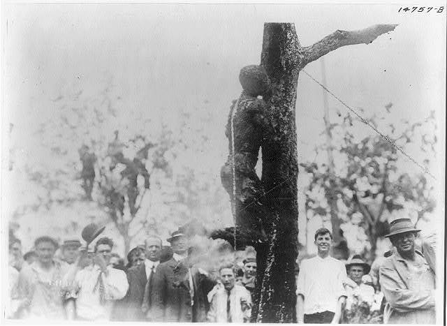 [Large crowd looking at the burned body of Jesse Washington, 18 year-old African American, lynched in Waco, Texas, May 15, 1916]