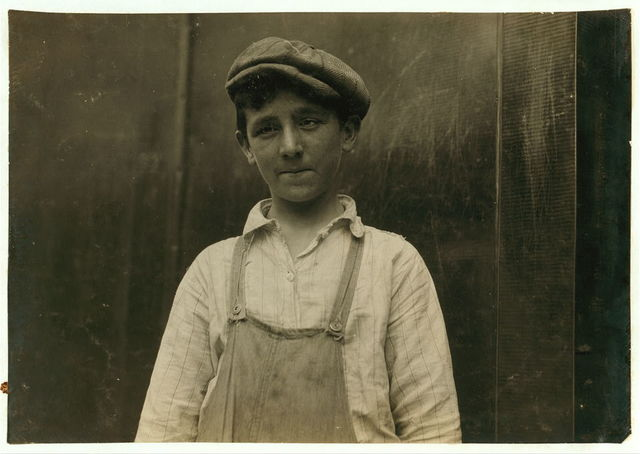 Lawrence Burns - Doffer - 14 years. Pocasset Mills. 43 Langley St. Eye defect.  Location: Fall River, Massachusetts / Lewis W. Hine.