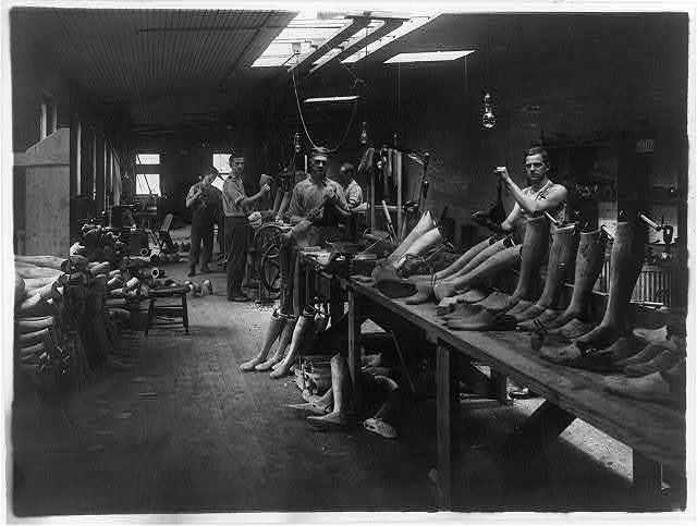 Men at work [making artificial legs] in the J.E. Hangar shop, a manufacturer of artificial limbs in Washington, D.C.