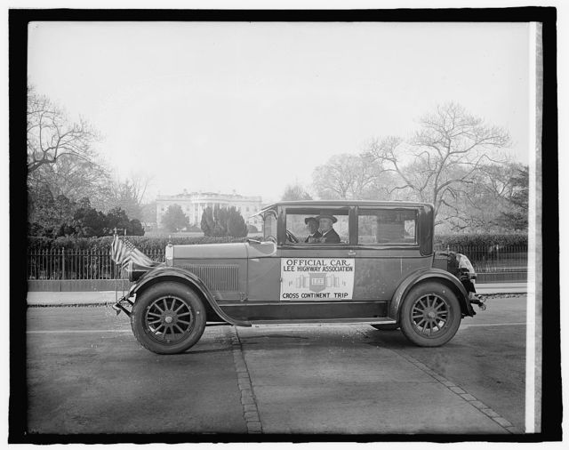 Mrs. J.A. Whitcomb [Official Car, Lee Highway Association, Cross Continent Trip; White House, Washington, D.C., in background]