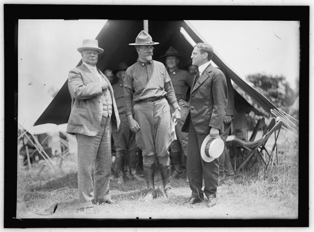 NATIONAL GUARD OF D.C. GEN. HUGH L. SCOTT; COL. WILLIAM HARVEY; SEC. OF WAR BAKER. ANTON STEPHAN IS AT REAR BETWEEN HARVEY AND BAKER