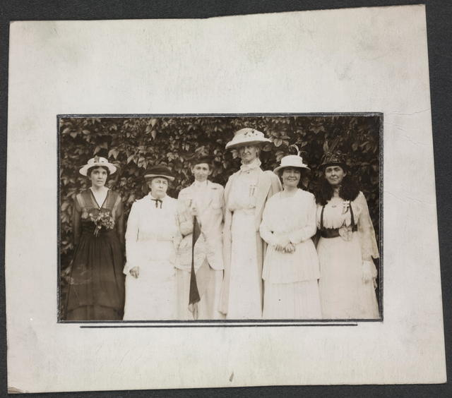 [National Woman's Party members meet in Colorado Springs for a conference to decide a course of action during the 1916 presidential election campaign.] Aug. 10--11 to 15, 1916.  Left to right: Mrs. Hetty Wallis, Texas, Advisory Council, Harriot Stanton Blatch, N.Y., Florence Bayard Hilles, Del., Bertha Fowler, Colorado, Anne Martin, Nevada, Mrs. William Kent, California.  Colorado Springs Conference 1916.