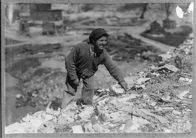"Oscar Revinsky(?) - Born Jan. 11, 1900, 15 years old - 99 Oak Grove Ave. A scavenger on Pine St. Dump. Case known to S.P.C.C. (record No. 4322) since 1910. In 1913 parents refused to let child be committed to Wrentham, Mass. In 1916 father came to office asking that boy be committed as he spent all his time on the dumps. Deficient mentality. Neck covered with scars and boils. ""No work - no school"" since 1912. Never cleans up. Doesn't go home to meals. Eats from dump and steals from dinner pails. Hard for him to tell where he lives. Thought 92 Oak Grove Ave. Was in baby grade at Ruggles School and was expelled. ""Is father alive?"" ""No, he's a milkman."" Fall River, Mass. 6/22/16.  Location: Fall River, Massachusetts / Lewis W. Hine."