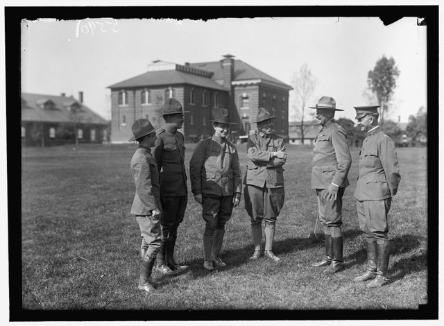 PLATTSBURG RESERVE OFFICERS TRAINING CAMP. REGULAR ARMY OFFICERS IN COMMAN, RIGHT, TALKING TO SOME D.C. MAN