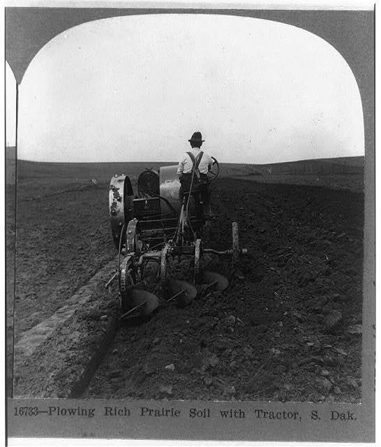 Plowing the rich prairie soil with tractor, S. Dak.