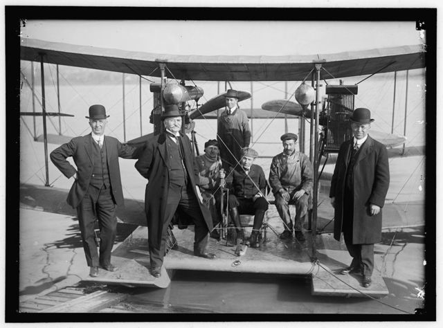 RICHARDSON TANDEM BIPLANE HYDROPLANE ON POTOMAC, APRIL, 1916. GEORGE A. GRAY AT CONTROLS. AT LEFT AND RIGHT ARE RICHARDSON BROTHERS WHO BUILT THE PLANE; 2ND FROM LEFT IS THEIR UNCLE, WHOSE IDEA IT WAS