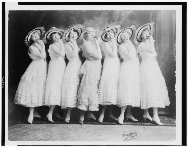 "[Seven ""Canary Cottage"" young women of the burlesque theater, posed, full-length, standing] / Hartsook photo, S.F.-L.A."