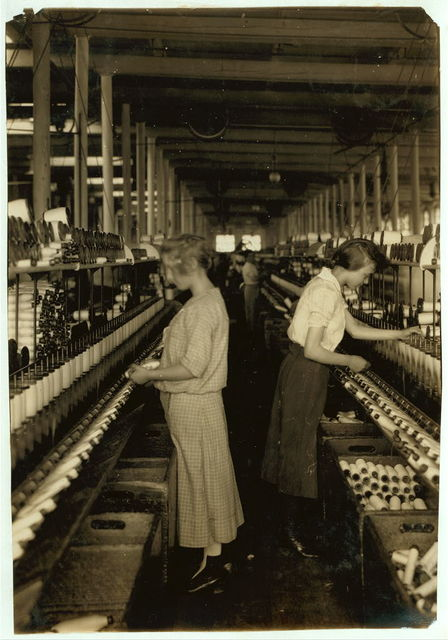 Spooler tenders - 14 and 16 years. Berkshire Cotton Mills.  Location: Adams, Massachusetts / Lewis W. Hine.