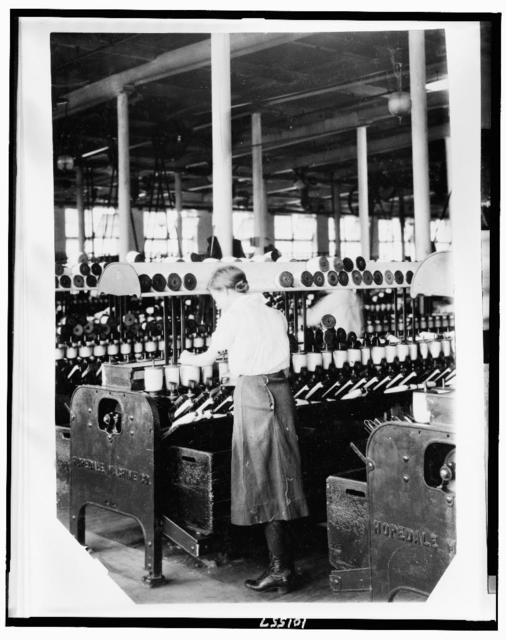 Spooler tenders - 14 years old. Berkshire Cotton Mills.  Location: Adams, Massachusetts / Lewis W. Hine.