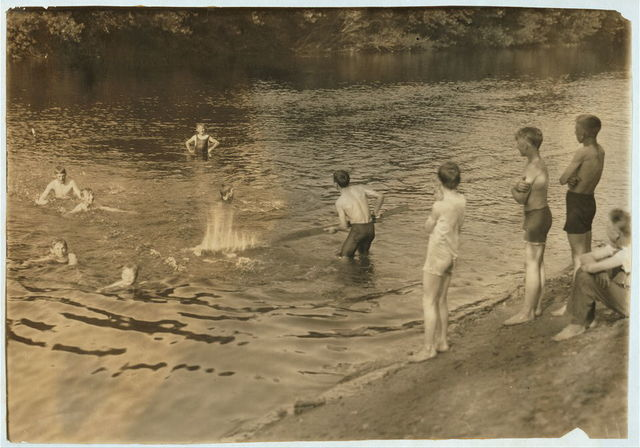 [The Swimming Hole. Group of boys - 14 to 16 years - just returned from working in tobacco at Southwick, Mass., on Galpin's farm.]  Location: Westfield, Massachusetts. / Lewis W. Hine.