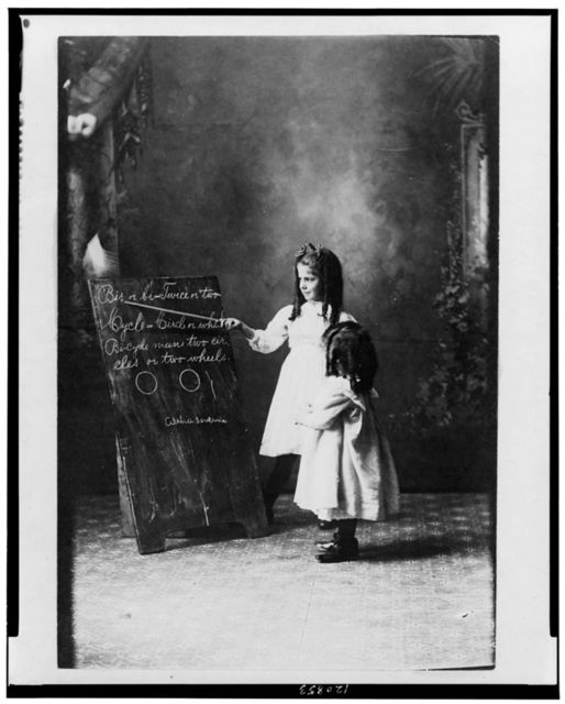 [Two young girls at a blackboard]