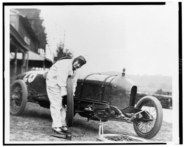 [Woman changing tire of Stutz Weightman Special no. 26 on Benning race track, Washington, D.C., area]