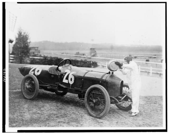 [Woman putting water in radiator of Stutz Weightman Special no 26. on Benning race track, Washington, D.C., area]