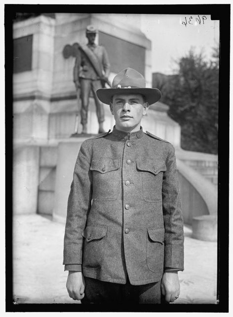 [Young man in uniform standing in front of Sherman Monument, Washington, D.C.]