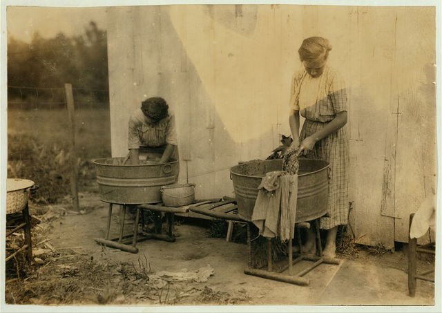Zelina & Florence Richards, 12 and 13 years old doing the family wash. Lewis W. Hine. See 4409.  Location: Nicholas County, Kentucky.