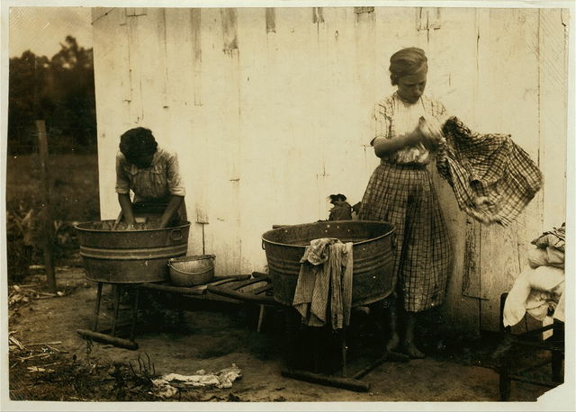 Zelina & Florence Richards, 12 and 13 years old doing the family wash. See 4409.  Location: Nicholas County, Kentucky / Lewis W. Hine.