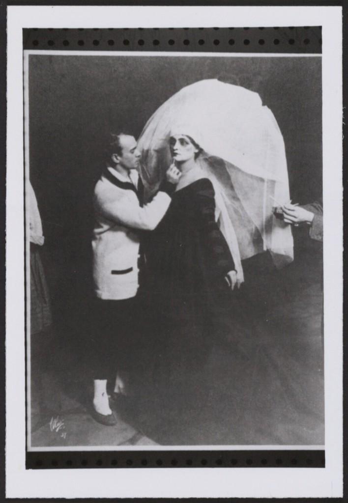 Photograph of Vaslav Nijinsky applying makeup to an artist before a performance of Til Eulenspiegel, New York 1916, no photographer