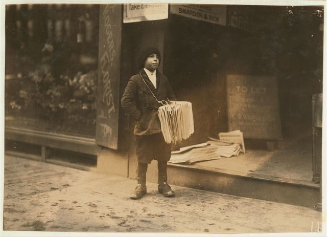 4 p.m. Morrison Foster, 37 Anderson Street. Said he was 12 years old, and sells papers from 4 to 6 p.m. daily. No badge visible--pinned inside pocket. Near South Station.  Boston, Massachusetts / Lewis W. Hine.
