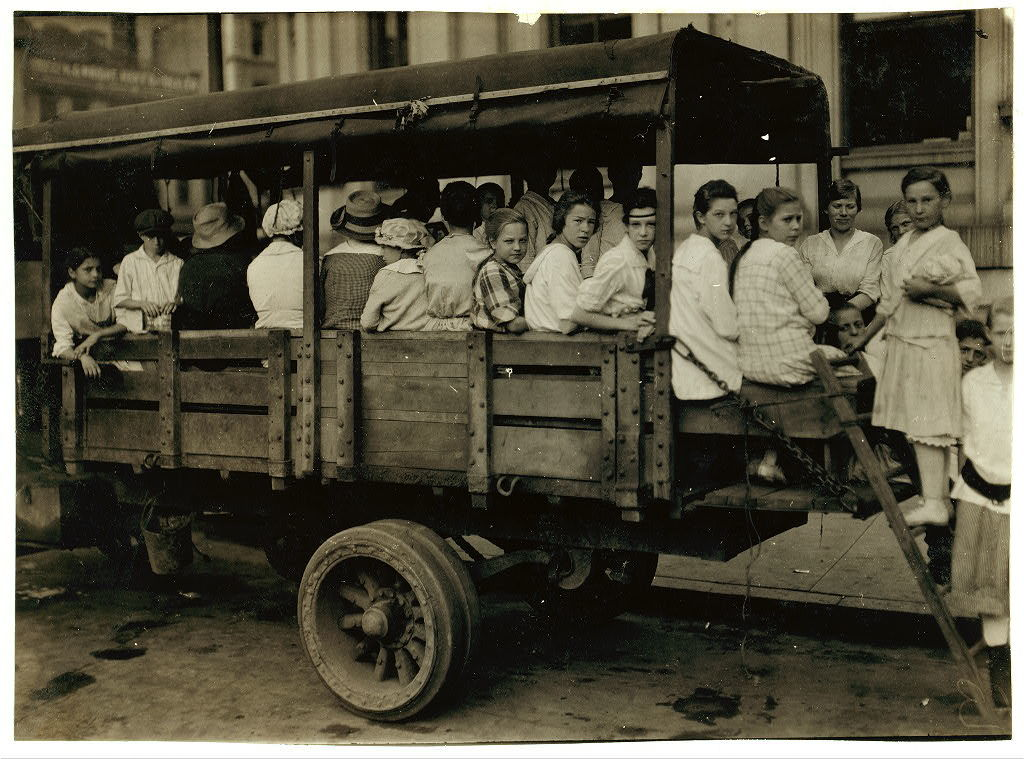 6:00 A.M. at Post Office Square. Truck load of tobacco workers bound for American Sumatra Tobacco Farm, S[outh] Windsor. They return about 7 P.M.  Location: Hartford, Connecticut / L.W. Hine.