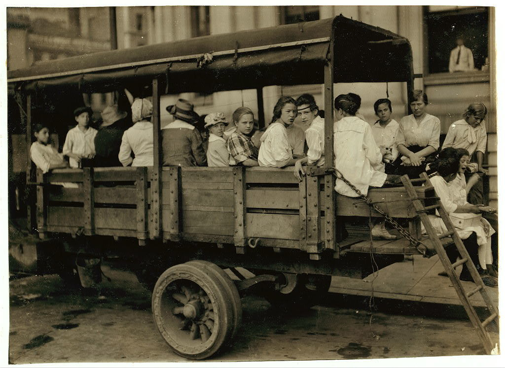 6:00 A.M. at Post Office Square, Truck load of tobacco workers bound for American Sumatra Tobacco Farm. S[outh] Windsor. They return about 7 P.M.  Location: Hartford, Connecticut / L.W. Hine.