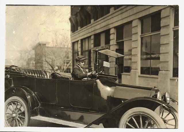 "A young chauffeur. See Hine report re: 15-year-old chauffeur in Oklahoma City who killed a man by careless driving. His case was dismissed because he was ""too young to prosecute."" Yet he was driving a taxi for a livery man and with no license.  Location: Tulsa, Oklahoma / Lewis W. Hine."