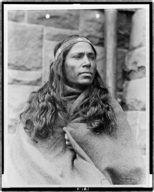 [Baby Lone, Kickapoo medicine man, half-length portrait, facing right, wrapped in blanket]