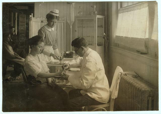 Bandage on injured finger in Hospital. Hood Rubber Co., Cambridge.  Location: Cambridge, Massachusetts / Lewis W. Hine.