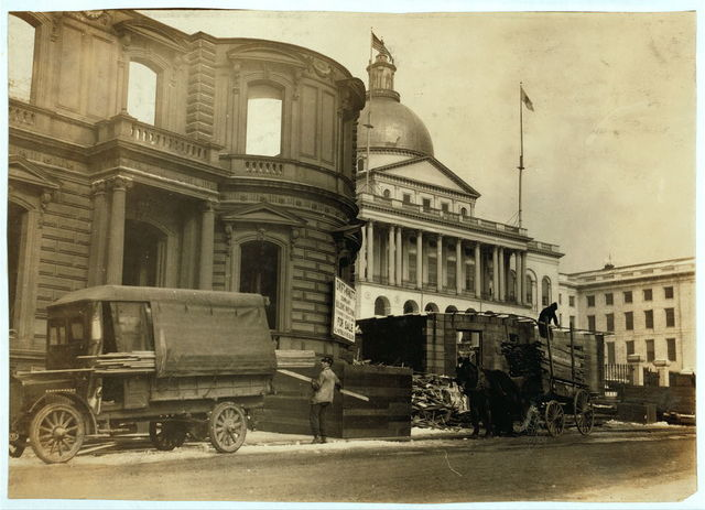 Beacon Street residence being demolished (next to State House) Young children carry the wood home.  Location: Boston, Massachusetts / Lewis W. Hine.