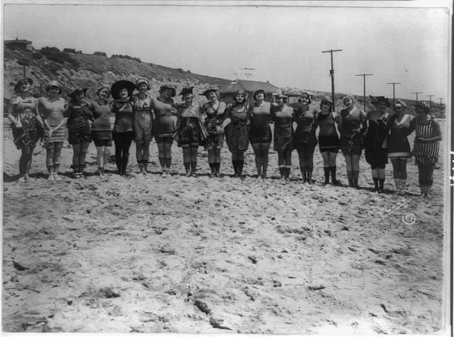 [Bevy of eighteen young women in bathing costumes on beach posed for Mack Sennett Productions] / Evans, L.A.