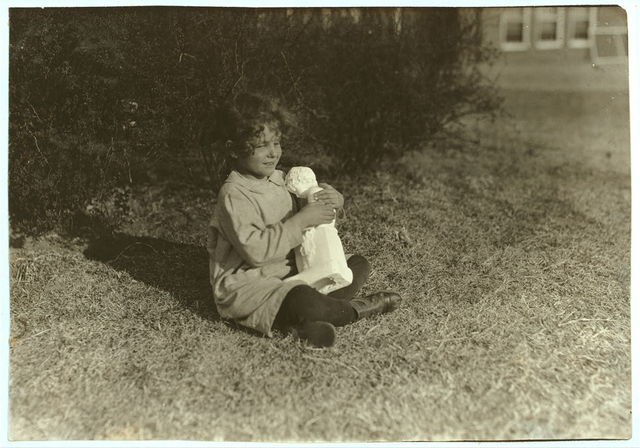 [Blind child making the acquaintance of a bit of statuary at Oklahoma School for the Blind. See Ellis report.]  Location: [Muskogee, Oklahoma] / [Lewis W. Hine]