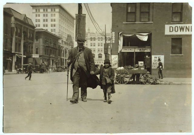 Blind man and his youthful guide.  Location: Oklahoma City, Oklahoma / Lewis W. Hine.