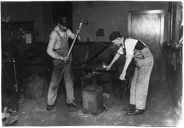 Boys working at forging. Oklahoma City High School.  Location: Oklahoma City, Oklahoma / Lewis W. Hine.