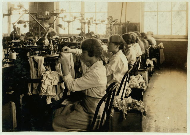 Continuation school girls looping stocking in Ipswich Mills.  Location: Boston, Massachusetts / Lewis W. Hine.